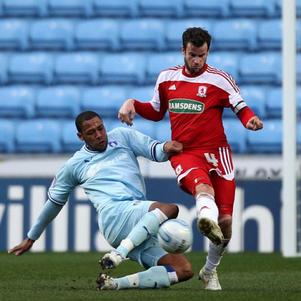 GROUNDWORK: Middlesbrough's Matthew Bates vies for possession with Coventry City's Clive Platt