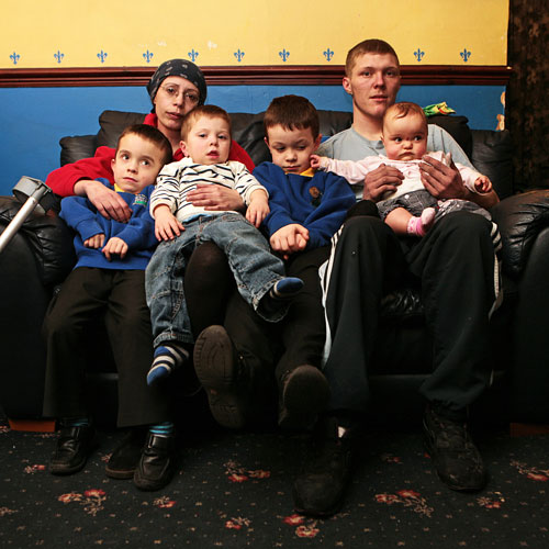 'LOST EVERYTHING': Dawn Milburn and James Maddison with, from left, Jack, Ben, Josh, and eight-month-old Casey-Ann