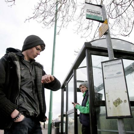 GOING NOWHERE: Apprentices Connor Vernon and Matthew Burrell, both 18, from New College Durham, wait at the bus stop opposite St Cuthbert's Avenue, in Framwell Moor, Durham, which Durham County Council spent more than £5,000 replacing