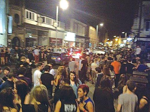 PROMOTED ON FACEBOOK: Hundreds of teenagers spill on to the street after the party is shut down