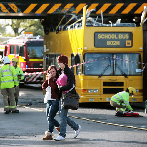 PUBLIC INTEREST: Students at the scene of a bus crash in Darlington in September last year