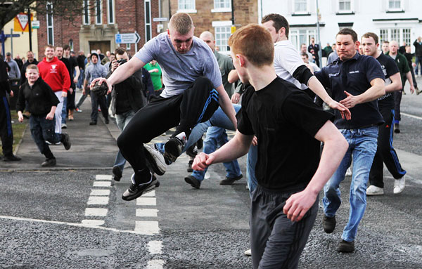 KICKING OFF: It's pretty much every man for himself as the annual Shrove Tuesday football match gets under way in Sedgefield