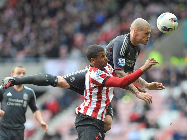 MY BALL: Liverpool's Martin Skrtel gets head and shoulders above Fraizer Campbell