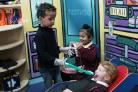OPEN WIDE: Children play with dentist toys at Layfield Primary School nursery. From left, Ruben Ta tham, Gurchan Singh and Megan Ridley, all four