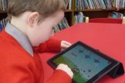 A pupil uses a school iPad but the 'Bring Your Own Device' concept is being adopted in our schools