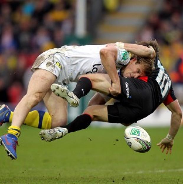Saracens Chris Wyles is tackled by Clermont's Aurelien Rougerie