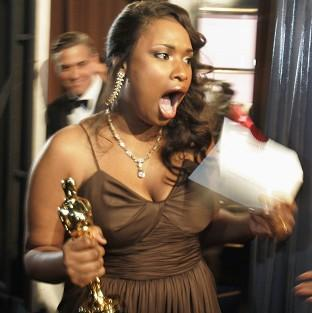 "FILE - In this Feb. 25, 2007 file photo, Jennifer Hudson reacts backstage after winning best supporting actress for her work in ""Dreamgirls"" during the 79th Academy Awards in Los Angeles. More accustomed to walking a red carpet in Vera Wang ball"