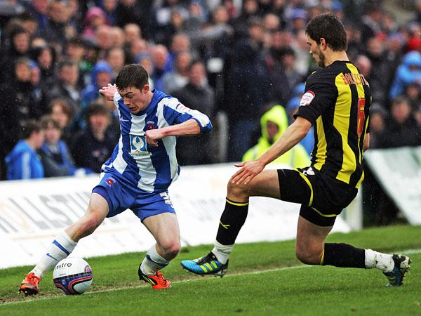Hartlepool's Luke James takes on Brentford's Pim Balkestein