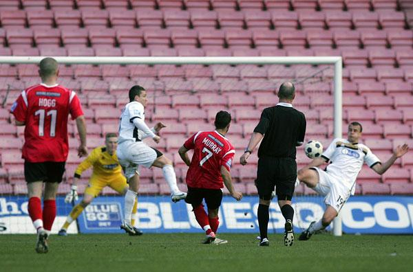 DROP GOAL: Scott Murray fires the goal which condemned Darlington to relegation