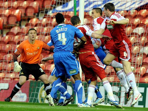 SCRAMBLE: The ball gets stuck between a pack of Boro players as they try to force an opening last night, only to draw a familiar home blank