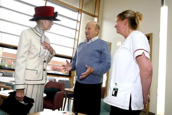 Princess Alexandra talks with Harold Winspear, the first patient to have treatment in the new centre's linear accelerator, and radiographer Karen Pilling.