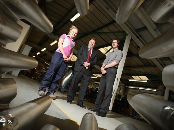 GREAT POTENTIAL: Graham Payne, managing director of Darchem, flanked by apprentices James Watmore and Libby Johnson