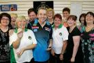Darts player Phil Taylor at JJB Sports shop with Darlington Darts ladies from left Debbie Fells, Karen Wright, Jackie Lockerbie, Christine Peart, Della Halliday, Bernie Ruffels, Carol Irvine, Vicki Hepworth Karen King and Ann Morrigan