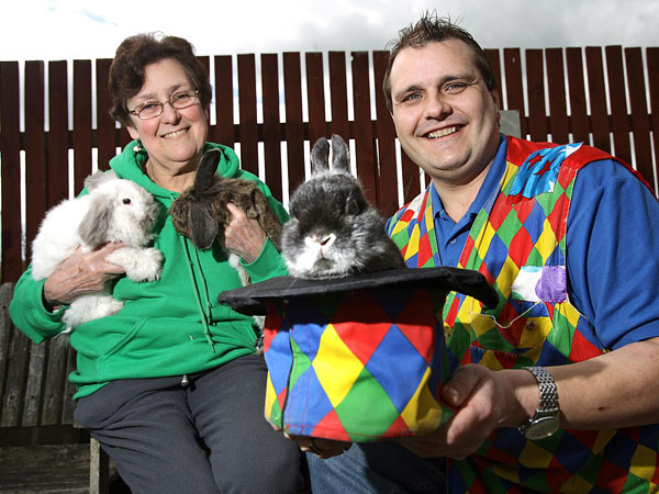 Magician Ian Wragg with his new rabbit, Dante, and Gwen Butler, of Bunny Burrows, holding rabbits Maybeline (white) and Arkwright (brown)