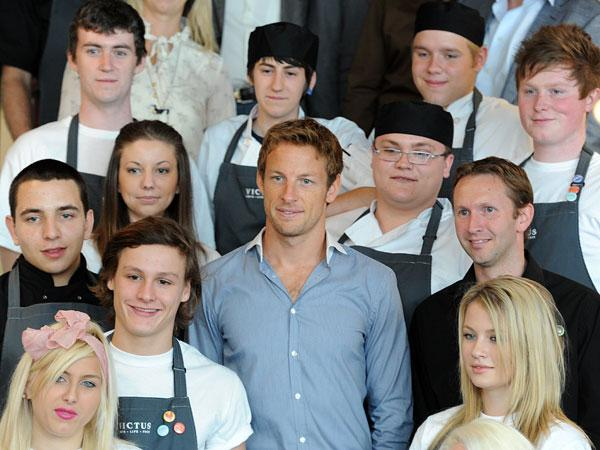 LAUNCH NIGHT: Jenson Button, centre, with staff at the opening