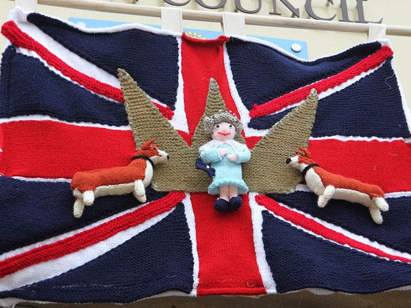 Yarn bombers create a Union flag with corgis and the Queen
