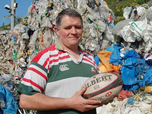 ME AND GILBERT: Former rugby professional Brett Cullinane at K&B Recycling, where he works as a recycling manager