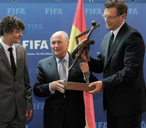 POIGNANT MOMENT: Shaun Campbell presents the statue to FIFA president Sepp Blatter and secretary general Jerome Valcke