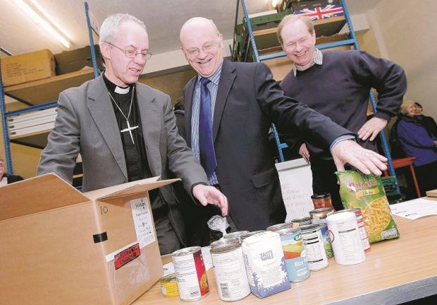 Durham Foodbank co-ordinator Peter MacLellan, right, with Justin Welby, now Archbishop of Canterbury, and Pastor Alan Bell