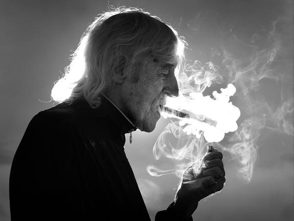 Sir Jimmy Savile enjoys a cigar at his home in Leeds four days before his death. Picture: Yorkshire Evening Post
