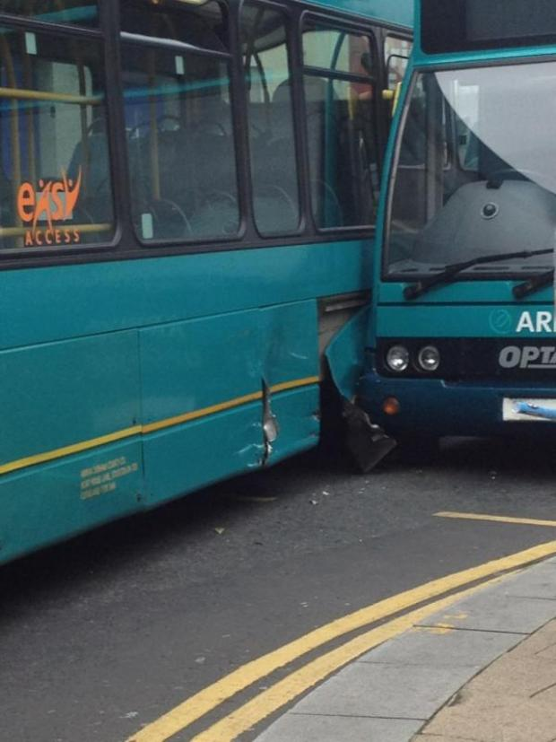 Caption: Two Arriva buses – one double-decker, one single-decker  - collide in Northgate, Darlington, close to Boots.  No one was hurt. An investigation has been launched.  Picture: STACEY FLETCHER