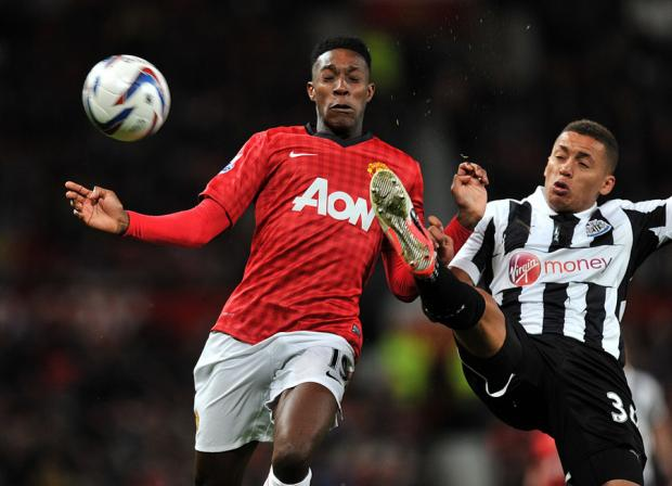 The Northern Echo: SHOULDER TO SHOULDER: Manchester United's Danny Welbeck goes for the ball alongside Newcastle's James Tavernier last night