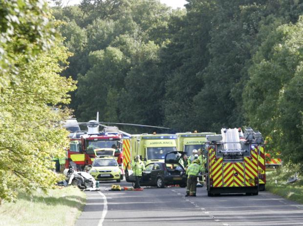 CRASH HORROR: Emergency services at the scene of the accident on the road near Barnard Castle