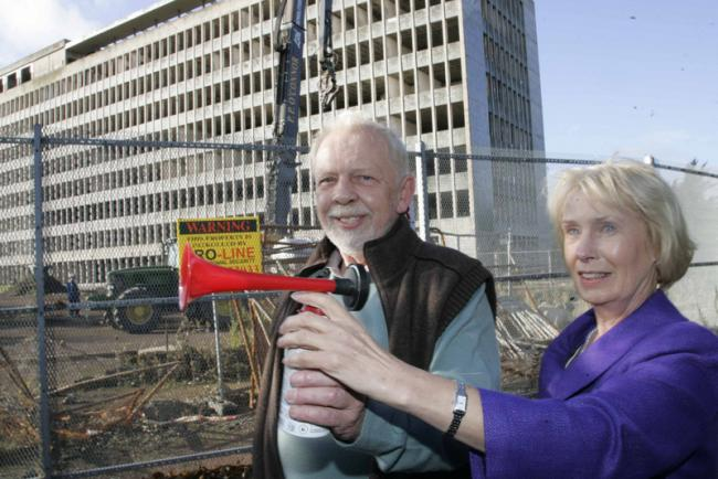 GET READY: Steve Whitehouse and Jo Cooper sound the hooter to start the demolition of the office block in Billingham