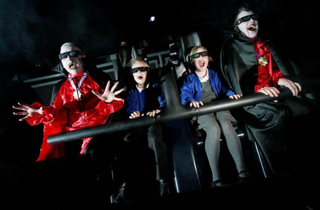 SCARE TACTICS: Science centre staff members Ian Simmons, left and William Haggarth join Reece and Erin, both seven and pupils at Fairfield Primary School. Stockton, on the 4D Dracula motion ride