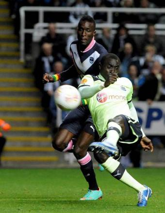 WONDERFUL DEXTERITY: Cisse hooks home Newcastle's goal to complete the comprehensive win