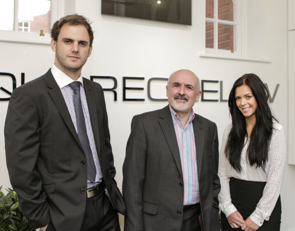 Trainees Ian Osborn, left, and Jenny Atkin, right, with Square One Law's training partner Barney Frith.