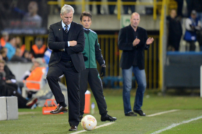 HE'S ON THE BALL: Pardew returns the ball back into play last night in the Jan Breydel Stadion