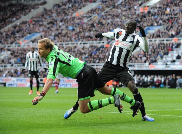 The Northern Echo: PALMED AWAY Newcastle's Papiss Cisse loses out to West Ham goalkeeper Jussi Jaaskelainen during the Premier League match at St James' Park