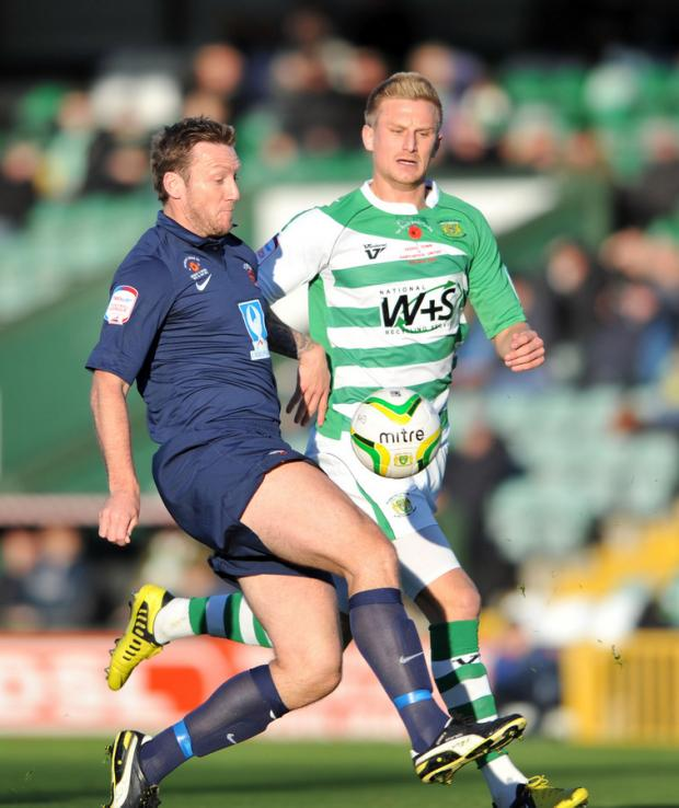 CLOSE ATTENTION: Steve Howard, left, is chased down by a Yeovil player