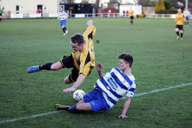TOUGH TACKLE: Newcastle Benfield's John Grey clatters into Norton & Stockton Ancients' Callum Martin. Norton won the game 3-1