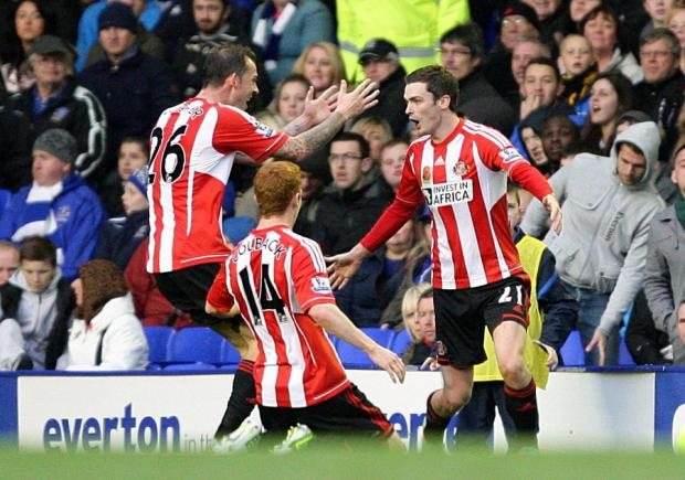 AT LONG LAST: Adam Johnson celebrates his goal with Jack Colback and Steven Fletcher – the first goal by a Sunderland player this season other than Fletcher