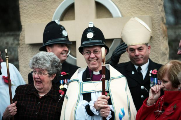 HATS OFF: Justin Welby swaps hats with local beat officer PC Keith Todd after blessing the new market cross in Sedgefield. The bishop invited PC Todd and his colleague, Sergeant Brian O'Connor, to pose for a photograph with him