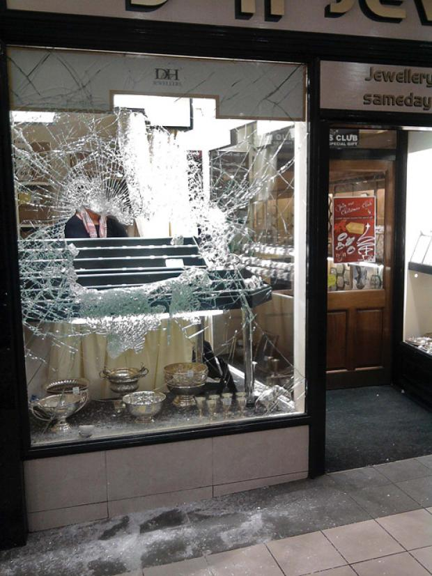 The smashed shop window at D&H Jewellers, in Queen Street, Darlington