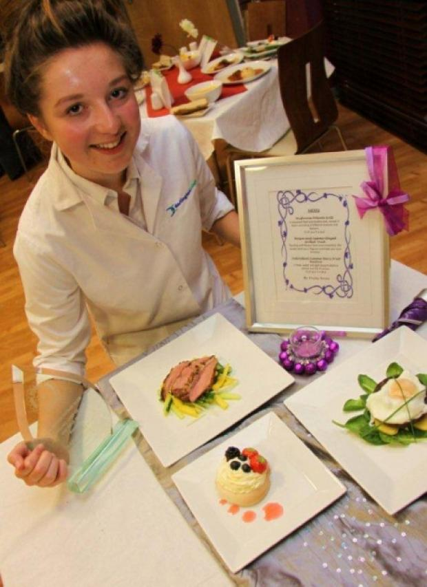Darlington Young Chef of the Year, Hayley Bowes, with her winning meal and trophy