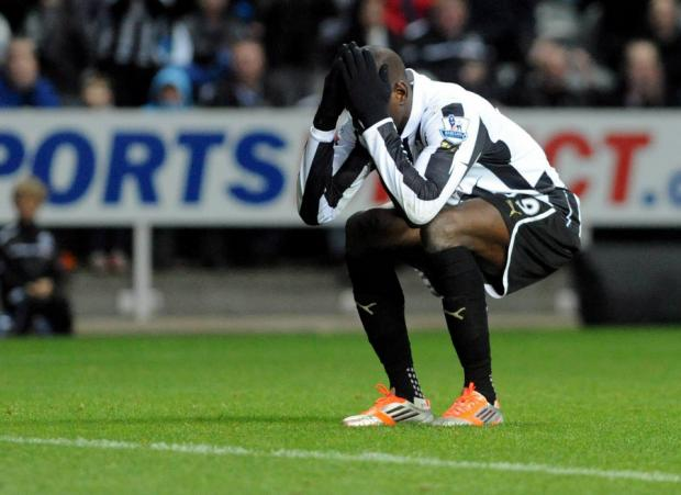 Demba Ba is dejected after missing another chance for Newcastle on Saturday. The Magpies lost their second home game in a row for the first time since 2008-09