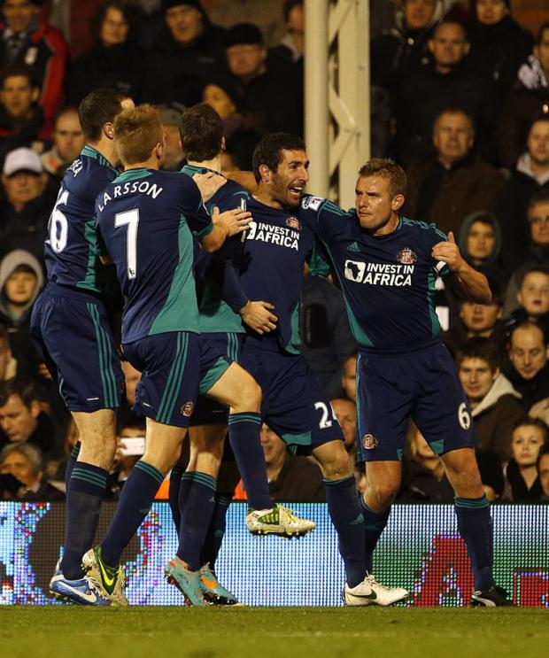 SPIRITED: Cattermole, right, celebrates Cueller's opener at Craven Cottage