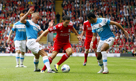 RIVERSIDE RETURN? Downing, pictured playing for Liverpool against Sunderland last season, could head back to Boro on loan