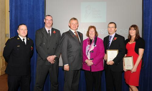BHS chairman Martin Clunes presents the award to Inspector Martin Peace and Diane Maughan, of Durham Police, Mark Gent, of the RSPCA, Ian Bousfield, of Durham County Council, and Jean Rogers, BHS northern region chairwoman.