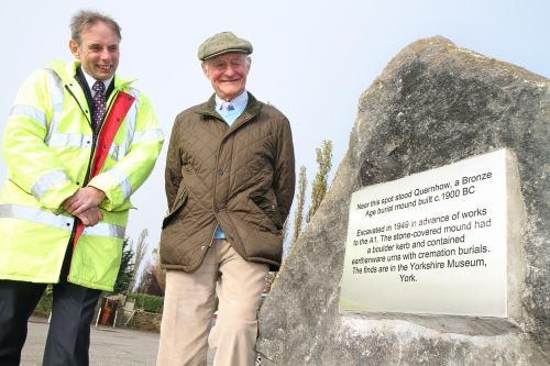 Highways Agency project manager David Brindle with former Quernhow Cafe owner Brian Lye with the new stone and plaque commemorating the Bronze Age burial mound.