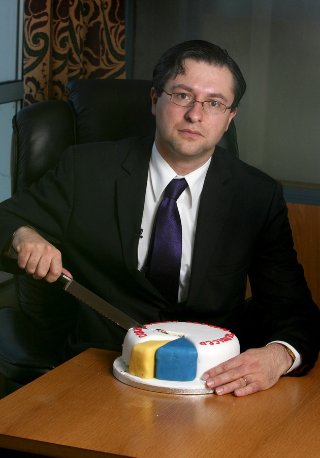 LOST SLICES: Durham County Council leader Simon Henig used a cake to show how much the authority lost out in the Comprehensive Spending Review last year