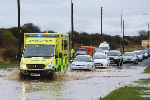 An ambulance makes it way to an emergency call through floods on Crimdon Terrace, Blackhall Rocks, near Hartlepool