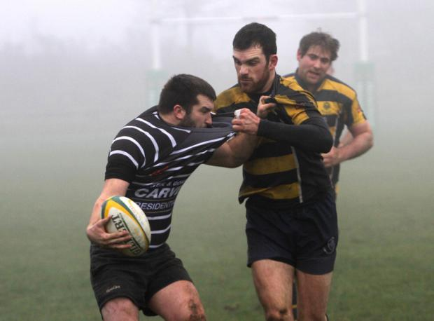 HOLDING ON: Michael Shepherd of Darlington gets to grips with his Durham City opponent during their 22-18 win