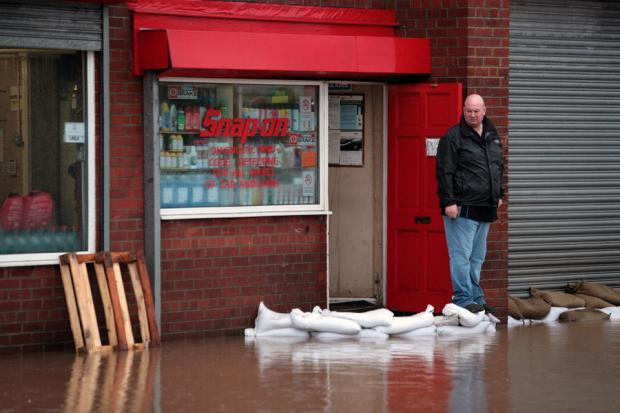 STILL RISING: Graham Cutler outside his flooded garage in Brotton Road, Carlin How