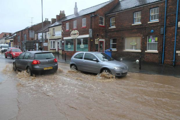 The Northern Echo: TRICKY CONDITIONS: Flooding in Friarage Street, Northallerton
