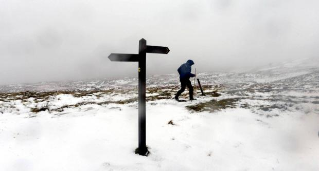 The Northern Echo: SNOW TRAIL: A walker endures bitterly cold temperatures as he negotiates the snowy hills in the northern Pennines yesterday